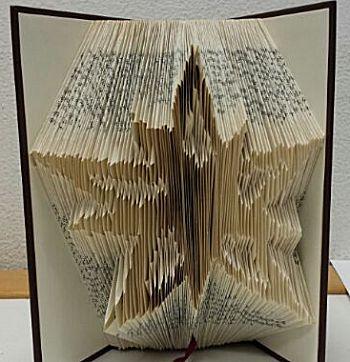 Vouw een boekkunstwerk kerstster
