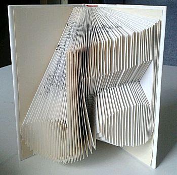 Vouw een boekkunstwerk Muzieknoten